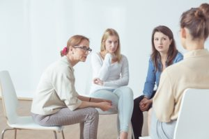 Group therapy session after a woman decided to choose the right rehab